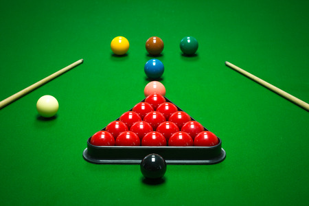 snooker balls set on a green table
