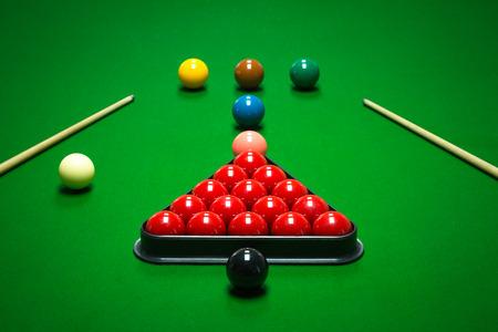 billiard ball: snooker balls set on a green table