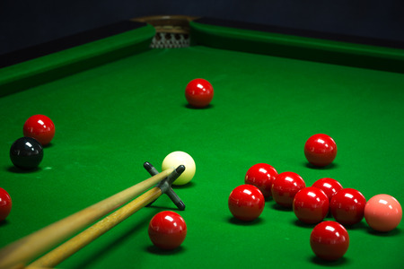 cue sports: snooker balls set on a green table
