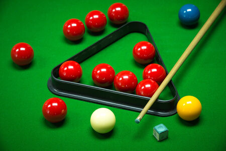 snooker balls set on a green table photo