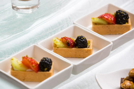 close up of square fruit tart in modern plate Stock Photo