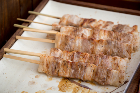 close up of thai style grill pork in bamboo stick Stock Photo
