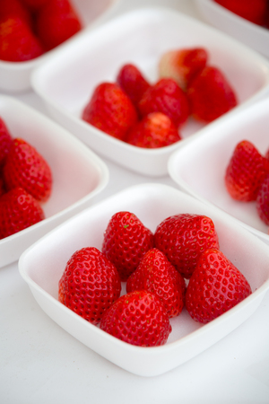 close up of fresh juicy strawberry in a white bowl