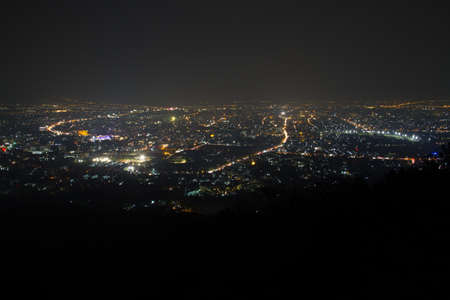 chiangmai: view of chiangmai at night time under mist