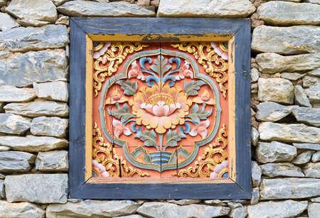harmonize: lotus carve on a rock wall