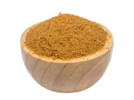 isolate of brown sugar in a wooden bowl