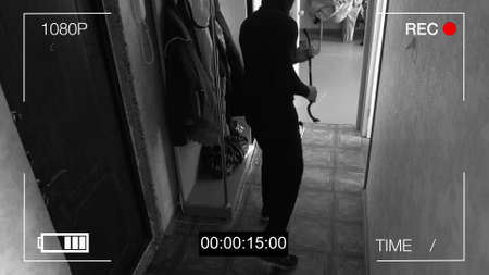 CCTV camera caught thief with a crowbar broke into the apartment.