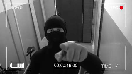 the masked robber burst through the door and threatened with a knife in CCTV camera.