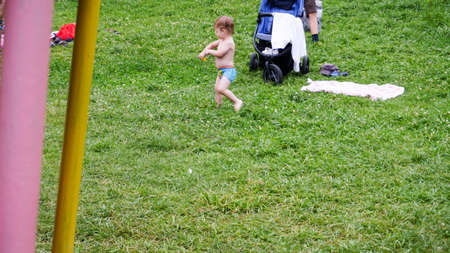 a small child plays on the grass.