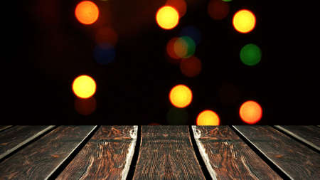Perspective wood and bokeh background of night and the shimmering glare of the lights. display template item.