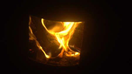 Hot fireplace full of wood and fire . Stockfoto