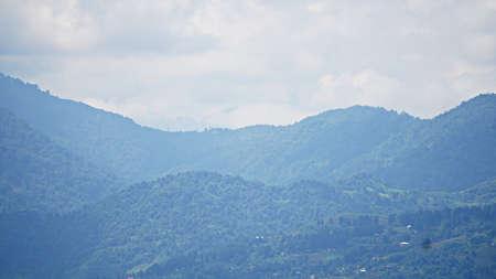 Mountain peak range landscape. Green mountain range view. Mountain peak blue sky white clouds panorama Stockfoto
