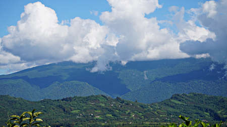 Mountain peak range landscape. Green mountain range view. Mountain peak blue sky white clouds panorama Banco de Imagens