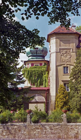View through trees of the 17th century Lancut Castle in Lancut Poland which now houses a museum Editorial