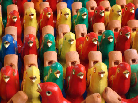 Beautiful pattern created from colorful bird statues
