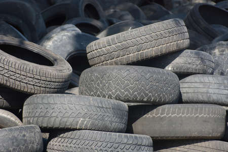 Pile of used old rubber tire photo