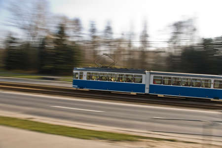 Street tram rushing on thier way on Krakow street in motion blur