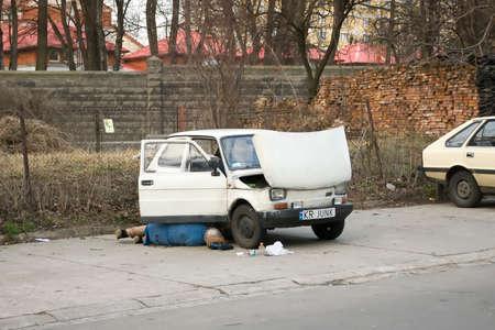 Guy Repair Junk White Car Fiat 126p
