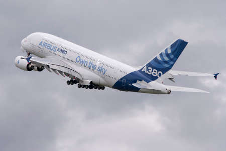 fuselage: Beautiful Airbus A380 double decker airliner taking off into cloudy sky