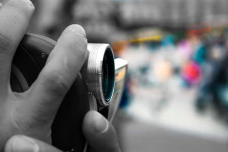 Close Up On Hands Holding Camera Lens With Nice Blurry Background