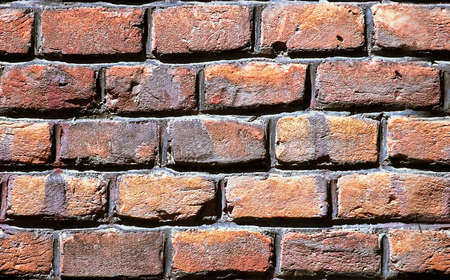 Close up view on repetitive grunge brick wall texture Stock Photo