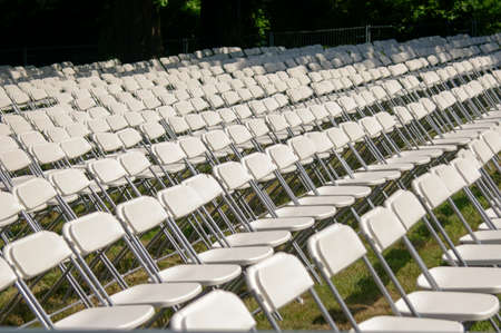White plastic chairs set for an outdoor event Stock Photo - 24732956
