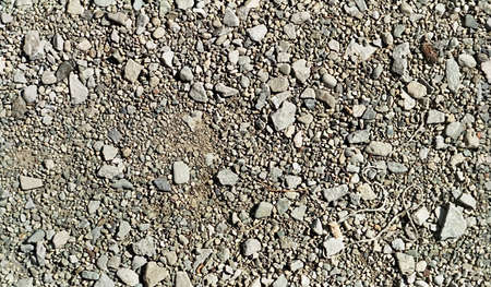 granular: Repetitive pattern of ground made of grainy small granular stones and gravel