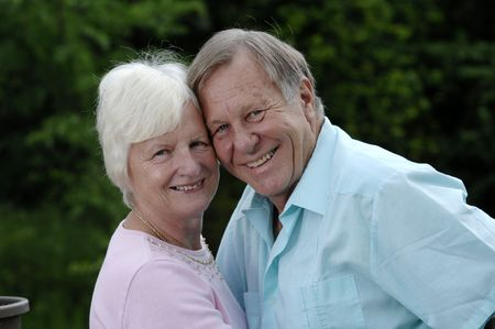 Senior romantic couple shares some intimate moments at their home.