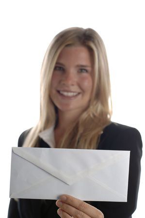 Young energetic business woman smiles as she holds blank envelope.