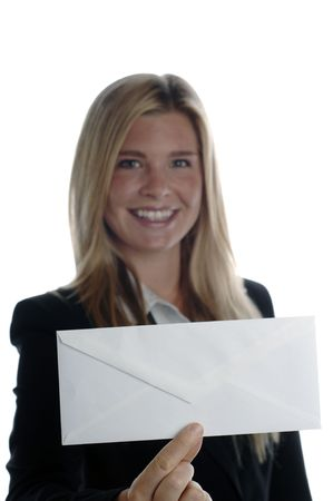 envelope: Young energetic business woman smiles as she holds blank envelope.