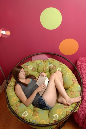 Teenage girl use cellphone in her room. photo
