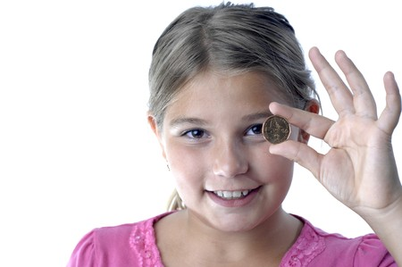 School girl is playing with a coin. photo