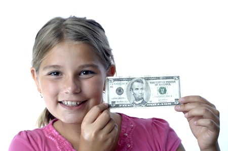 School girl is playing with a paper bills before putting them into the piggy bank.. Stok Fotoğraf