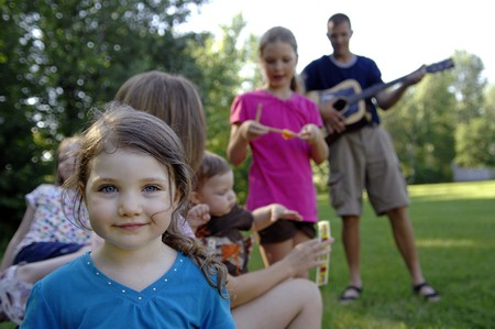 Young family on the grass at the backyard. Stock Photo
