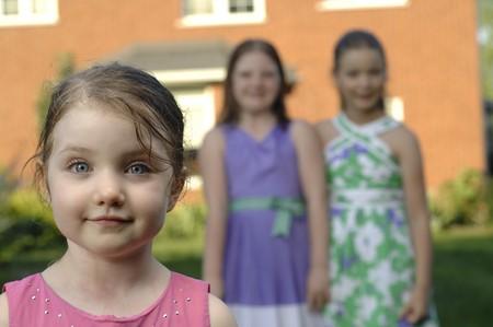 Cute girls play in the garden.