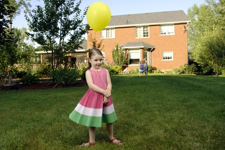 revolves: Cute girl play in the garden.