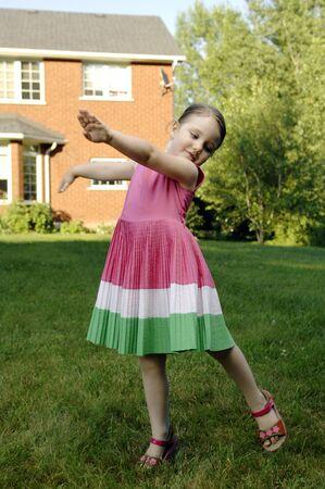 revolves: Cute girls play in the garden.