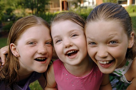 Three cute girls play in the garden. photo