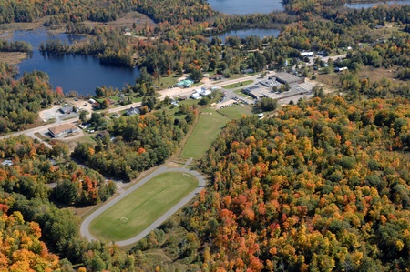 Aerial view of Small North American town with prominent football field.