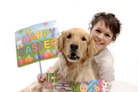 Young pretty woman and her dog hold Easter sign Stock Photo