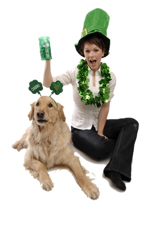 Young pretty woman and her dog celebrate St Patricks day.