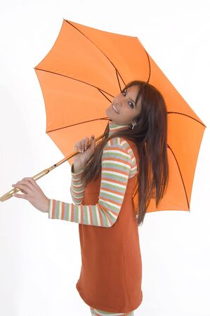 Pretty girl with orange umbrella in her hand photo