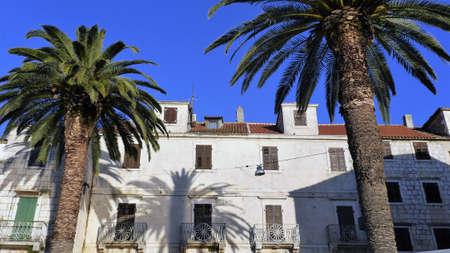 old windows: Old windows and balconies palm Komiza island Vis Croatia