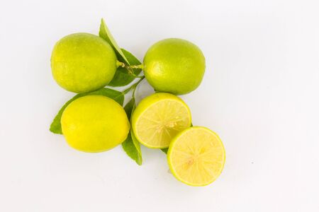 acetic acid: Some lime with little branch in the white background
