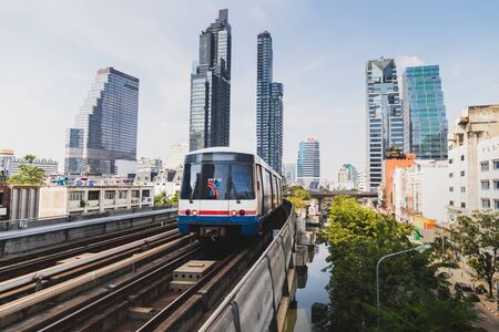 Bangkok, Thailand - January 12, 2019 :BTS Sky train mass transit system in Bangkok arrives to the station in the evening time Redakční