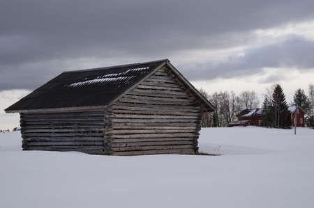 snowy field: wooden shack in a snowy field