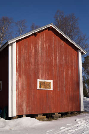 shanty: old red barn in Lapland Stock Photo