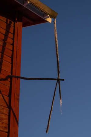 barns winter: A large icicle at a drainpipe
