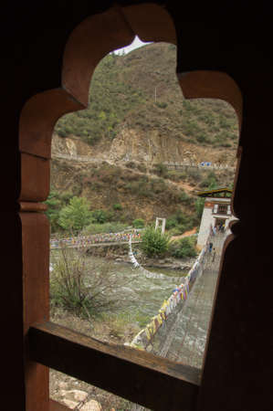 bhutan: metal bridge over Paro Chu river in Bhutan