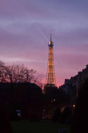 sun set: Eiffel tower illuminated at sun set Editorial